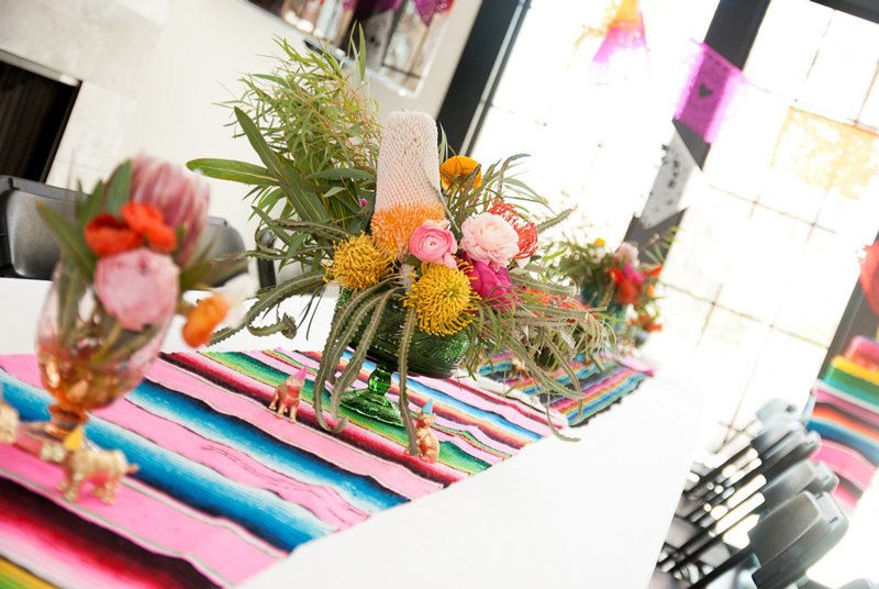 fiesta safari table setting with bright flowers