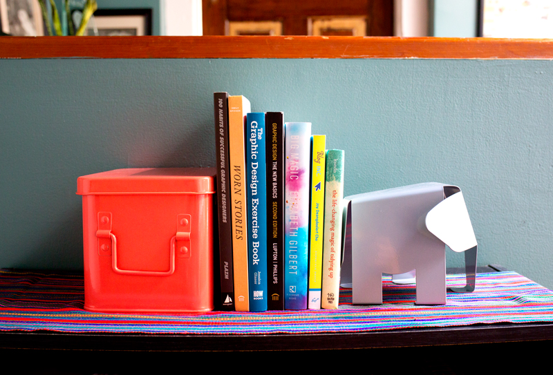 Books for creatives with a cute elephant book end. Click through for more home office decor ideas!