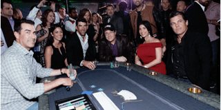 Rob Riggle, Nicole Phelps, Michael Phelps, Common, Jamie Gold, Josh Brolin and friends gathered around a custom BBO Poker Table as the star-studded poker tournament got underway