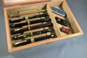 Churchill Robusto open with pens closeup