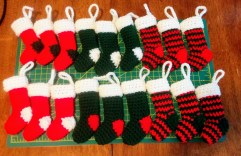 http://www.maggiescrochet.com/pages/mini-christmas-stockings-free-crochet-pattern