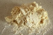 on the floured surface, knead for 2 min