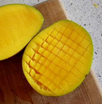 slice mango, cut onion and chop coriander