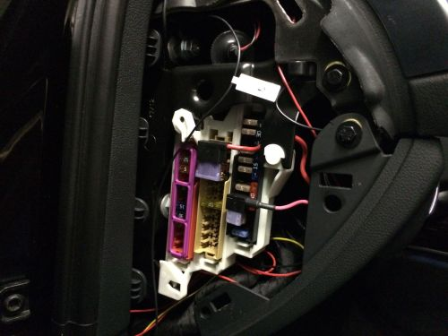 small resolution of location of interior fuse panel below and to the left of the steering wheel