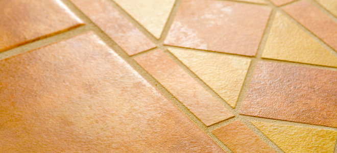 remove adhesive from ceramic tile