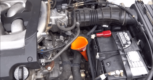 small resolution of figure 4 use a funnel to pour in the new fluid featured video how to check transmission fluid