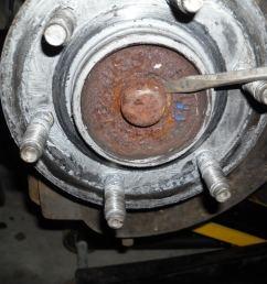 step 4 pop off wheel bearing cap [ 1024 x 768 Pixel ]