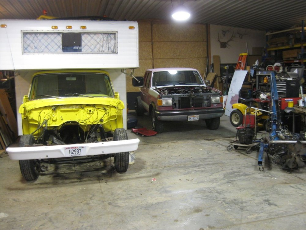 medium resolution of both of the trucks in the shed