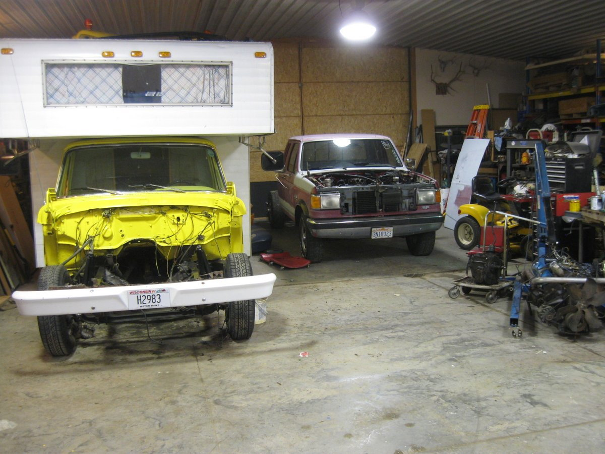 hight resolution of both of the trucks in the shed