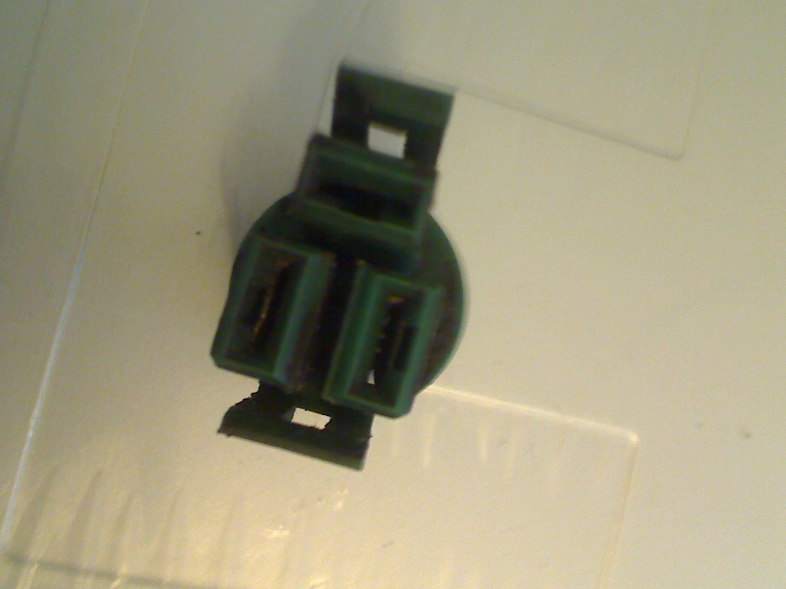 hight resolution of this is the square green plug that has two vertical slots and a horizontal one above them see photo
