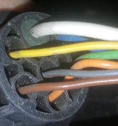 the picture is of my 7 way wiring harness and the center gray wire is for reverse if the color scheme changed it will still be the center wire  [ 1996 x 1149 Pixel ]