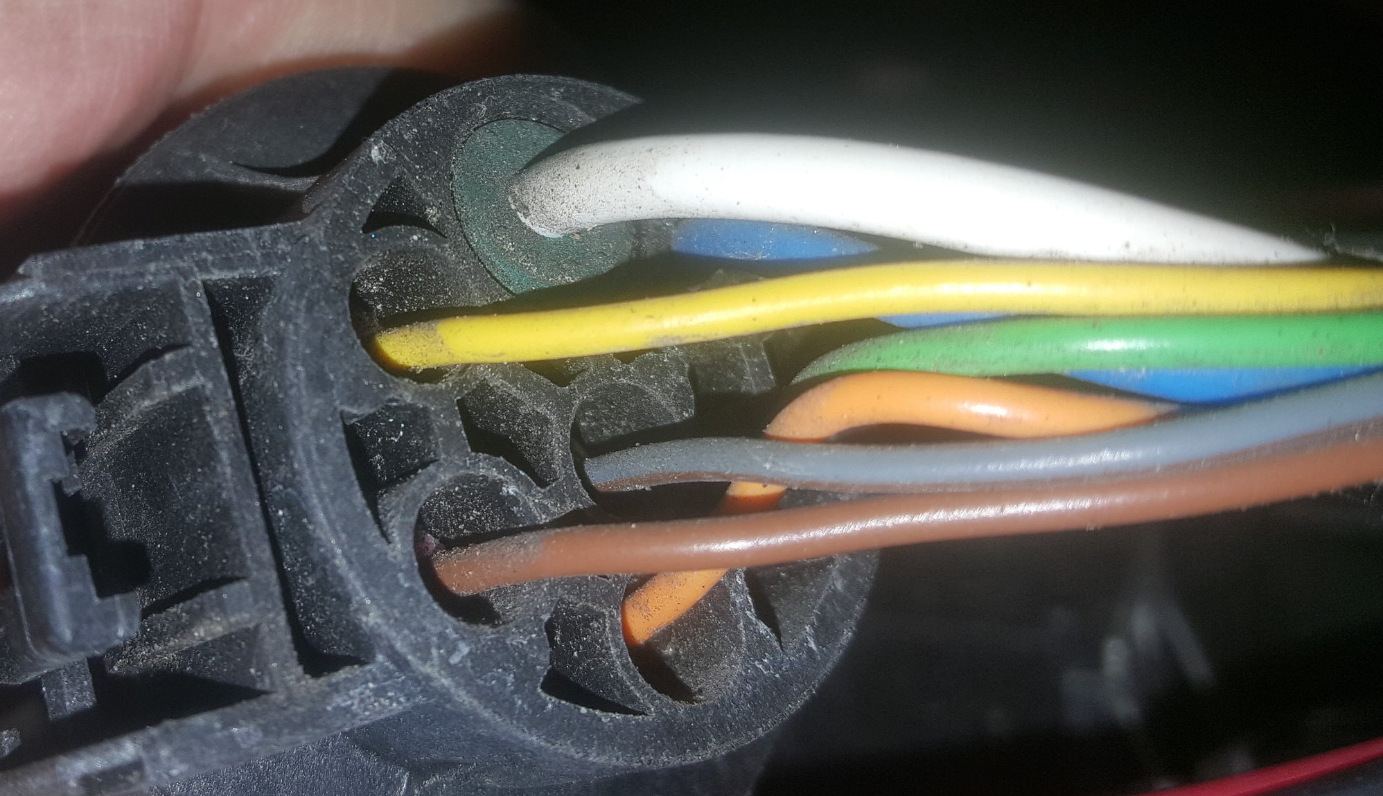 hight resolution of the picture is of my 7 way wiring harness and the center gray wire is for reverse if the color scheme changed it will still be the center wire
