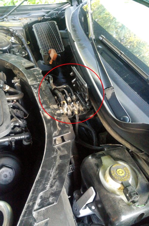 small resolution of panel is under the plenum cover and crossmember in the center rear of the engine compartment