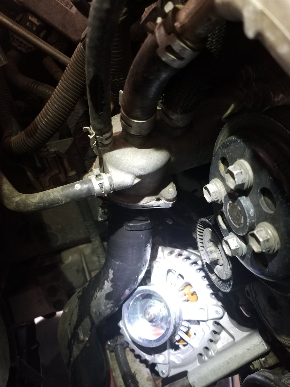 medium resolution of don t forget to slip the metal harness retainer back onto the front 14mm bolt while everything is loose otherwise if it s skipped you have to decide to do
