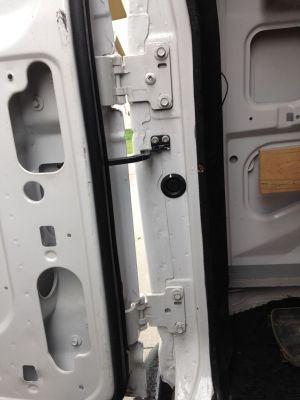 How do I adjust the rear doors on a E250 Cargo Van  Ford