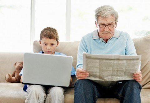 Grandson and grandfather sitting on a couch