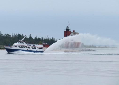 Ferry passing Round Island Light