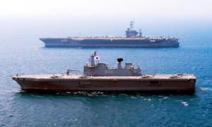 The ROKS Dokdo and USS George Washington on exercise together.