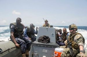 (April 2, 2014) - U.S. Sailors, U.S. Coast Guardsmen and Ghanaian maritime specialists, all embarked aboard joint, high-speed vessel USNS Spearhead (JHSV 1), ride in a rigid-hull inflatable boat (U.S. Navy photo by Mass Communication Specialist 2nd Class Jeff Atherton/ Released)
