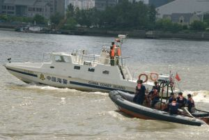(Aug. 18, 2007) SHANGHAI, China - The crew from the U.S. Coast Guard Cutter Boutwell trains with the China Coast Guard during the North Pacific Coast Guard Forum. (Coast Guard photo by Petty Officer Jonathan R. Cilley)
