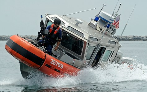 Boat crewmen with Maritime Safety and Security Team Los Angeles - Long Beach conduct tactical boat maneuvers during an exercise, July 31, 2012. The exercise was designed to test the unit's ability to protect a ship docked at a pier as well as underway, using four Coast Guard small boats.