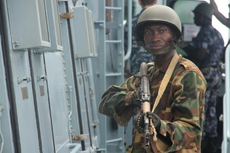 A Togolese soldier provides rearward security for the Togo boarding team on the bridge of the target vessel BRANDENBURG during OBANGAME EXPRESS 2015. (Photo: German Navy/Steve Back)