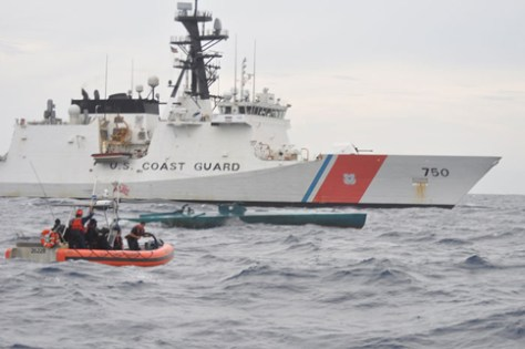 A Coast Guard Cutter Bertholf boarding team aboard an Over the Horizon Long-Range Interceptor boat approaches a self-propelled semi-submersible vessel suspected of smuggling 7.5 tons of cocaine in the Eastern Pacific Ocean, Aug. 31, 2015. The seized contraband is worth an estimated $227 million. (U.S. Coast Guard photo)