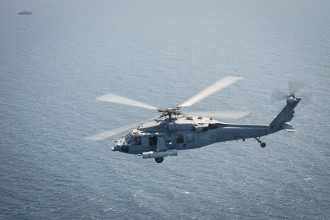 An MH-60S equipped with the Airborne Laser Mine Detection System (ALMDS) flies near Bahrain during the ALMDS' maiden deployment. The ALMDS will play a crucial role in quickly detecting moored minefields before friendly vessels enter an area, but the helicopter will require protection. U.S. Navy Photo.
