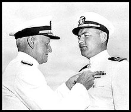 SLUG: ME/Cutter-ob DATE SHOT: 07/27/1944 (Downloaded 06/12/2005 by EEL) CREDIT: AP Photo/U.S. Navy CAPTION:Admiral Chester W. Nimitz pins the Navy Cross on Lt. Cmdr. Slade Cutter, right, for his exploits as a submarine skipper in raids against Japanese shipping on July 27, 1944 at a ceremony in San Francisco. Lt. Cmdr. Cutter of Vallejo and Hollywood, sank 18 Japanese ships, during three successive patrols in enemy-controlled waters. Cutter was also awarded two gold stars in lieu of second and third Navy Crosses.