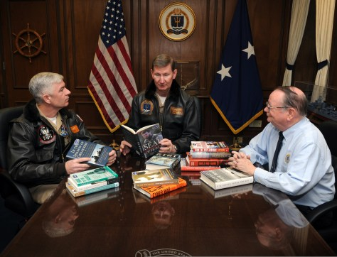 131210-N-PX557-035.NEWPORT, R.I..(Dec. 10, 2103).Cmdr. Daniel Dolan, deputy program manager, Chief of Naval Operations Professional Reading Program (CNO-PRP), Rear Adm. Walter E. ???Ted??? Carter Jr., president, U.S. Naval War College (NWC) in Newport, R.I., and professor John Jackson, program manager, CNO-PRP, participate in a collaboration of CNO-PRP books. The CNO-PRP is designed to enhance professional development, learn about Navy heritage and gain a greater understanding of what it means to be a 21st century Sailor. The 42 books in the collection are arranged in categories that align with the CNO???s three Tenets: ???Warfighting First,??? ???Operate Forward,??? and ???Be Ready.??? Books are available throughout the fleet in lending libraries aboard every ship, submarine, squadron and station throughout the Navy..(U.S. Navy photo by Chief Mass Communication Specialist James E. Foehl/Released).