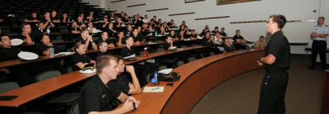 MIDN 2/c Zach Donnelly teaches fellow midshipmen about cyber security at the U.S. Naval Academy, October 2014. Credit: USNA