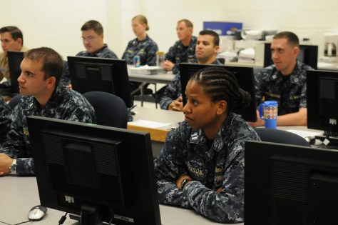 150828-N-PU674-005 PENSACOLA, Fla. (Aug. 28, 2015) Officers attending the Information Professional Basic Course at Center for Information Dominance Unit Corry Station listen to Rear Adm. Daniel J. MacDonnell, commander of Information Dominance Corps Reserve Command (IDCRC) and Reserve deputy commander of Navy Information Dominance Forces (NAVIDFOR). Macdonnell spoke with them about career opportunities in the Information Dominance Corps and active and reserve integration. (U.S. Navy photo by Carla M. McCarthy/Released)