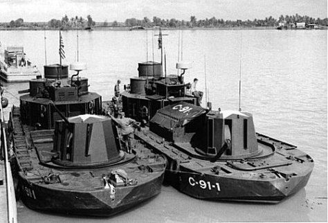 """Two Vietnam-era """"Monitor"""" riverine craft. The vessel at right has been modified to support C2 functions by replacing the mortar pit with a communications center. (Doug Lindsey via Rivervet.com)"""