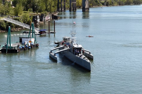 Sea Hunter, an entirely new class of unmanned ocean-going vessel gets underway on the Williammette River following a christening ceremony in Portland, Oregon. (U.S. Navy photo by John F. Williams/Released)