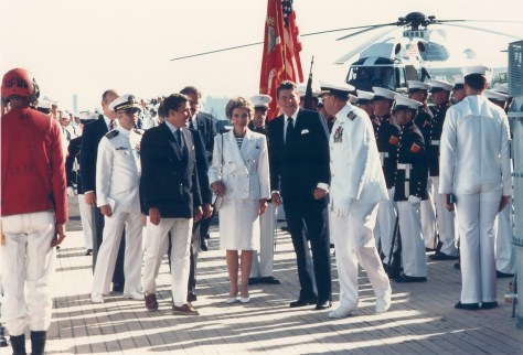 Navy Secretary John Lehman greeting President and Mrs. Reagan aboard the battleship Iowa for 100th anniversary celebration of the Statue of Liberty on July 4, 1986 in New York Harbor.