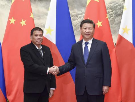 Chinese President Xi Jinping (R) holds talks with his Philippine counterpart Rodrigo Duterte in Beijing, capital of China, Oct. 20, 2016. (Xinhua/Li Xueren)