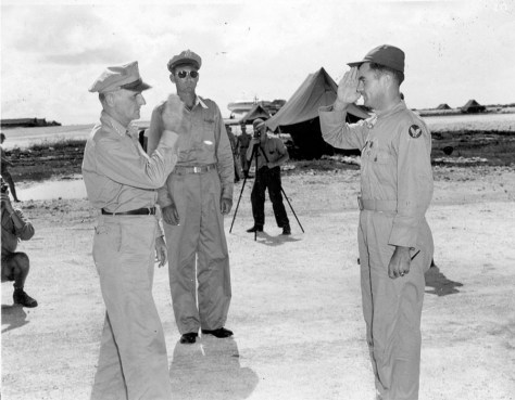 General Carl Spaatz decorates Tibbets with the Distinguished Service Cross after the Hiroshima mission/USAF Official Photo