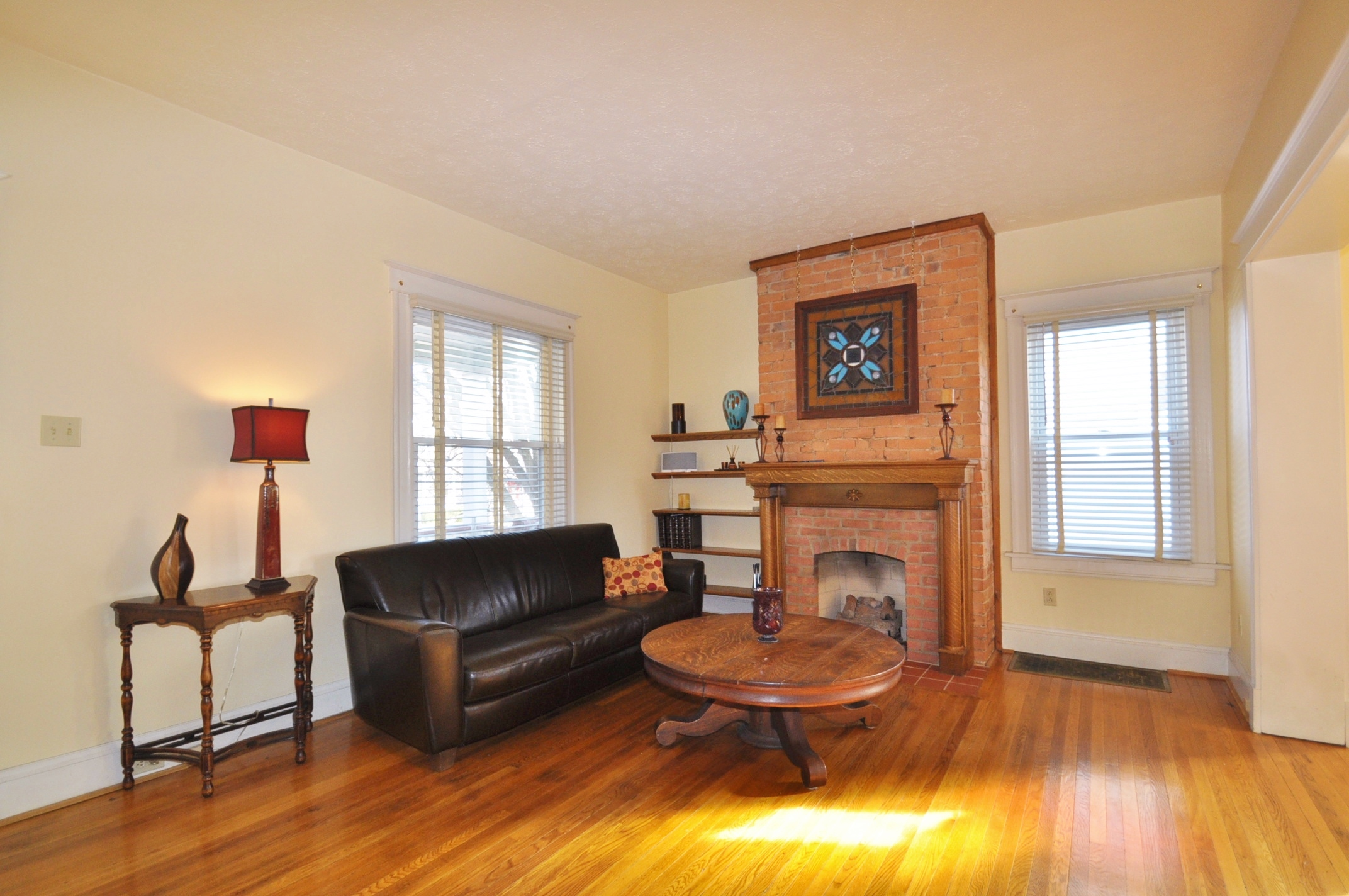 formal living room with brick fireplace best area rug for small exposed works any style cincinnati homes and real estate image
