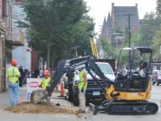 Duke's contractor tying Elm Street house's gas service to new the gas main.