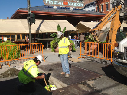 Work includes underground conduit for traffic control signals near Findlay Market.