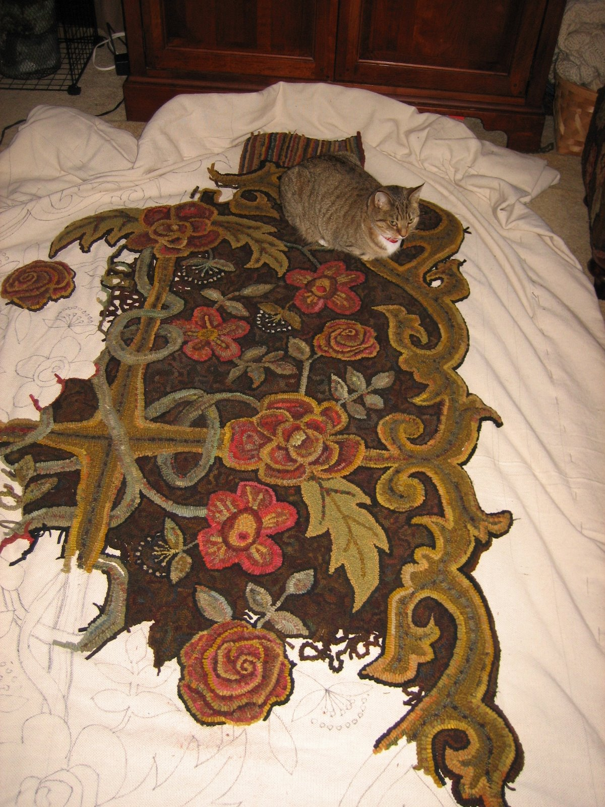 cats on room=sized hooked rug