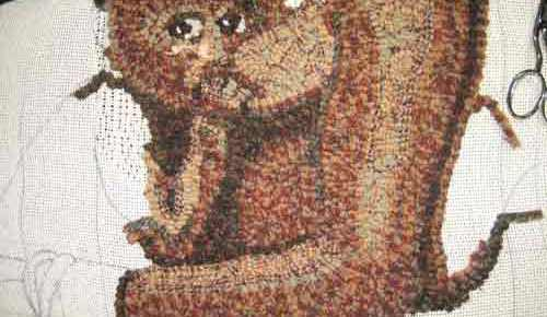 Rug hooking the mother's body