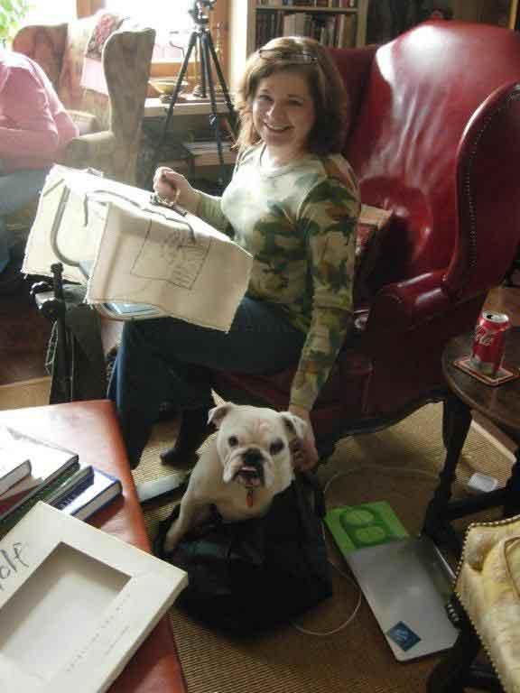 Cindi Gay rug hooking with Gladys the bulldog
