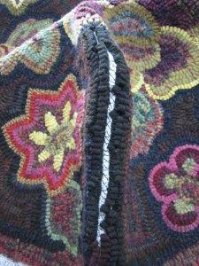 Second pass rug hooked footstool seam