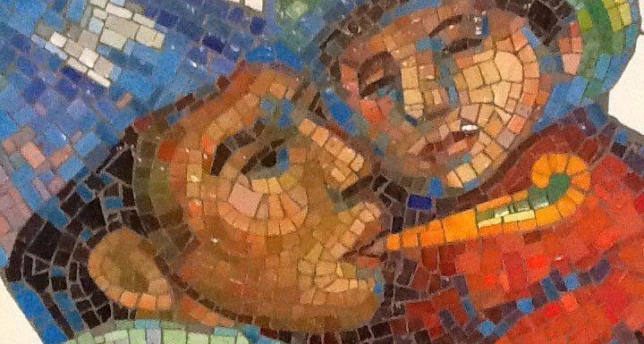 Tile art NYC subway closeup of man holding child