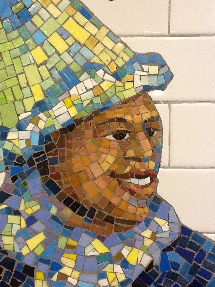 Tile art NYC subway smiling man