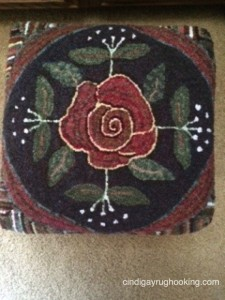 Rose Scroll footstool hooked by Pat Cassidy, designed by Cindi Gay