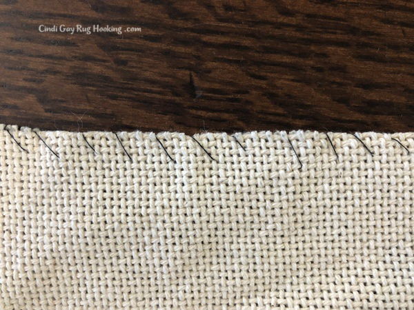 closeup of simple whip stitch to prevent fraying