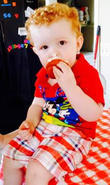 Westons second birthday eating cupcake