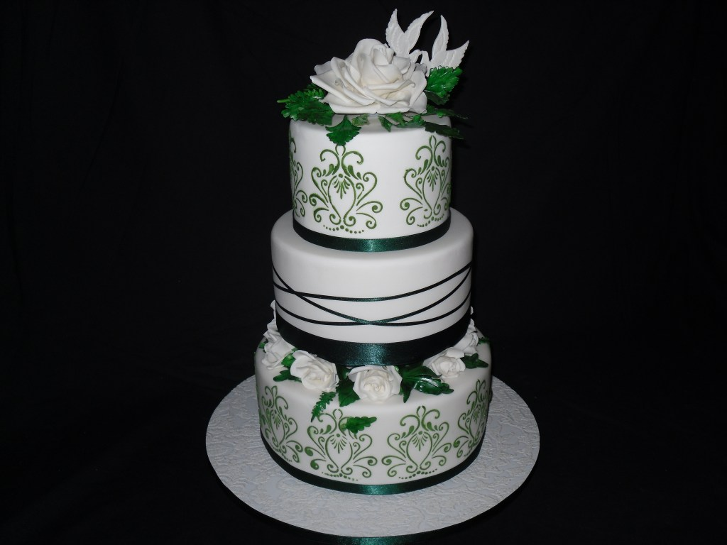 Green decorated 3 tier wedding cake
